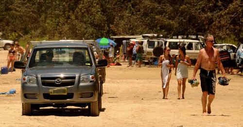 Minnie Water beach has turned into a car park this summer.