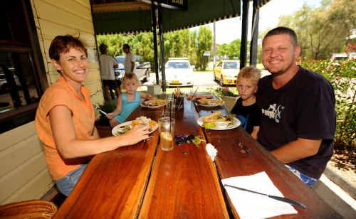 Sandra and Rick Johnson, of South Grafton, with their children Sophie, 2, and Liam, 4, having lunch at the Brushgrove Hotel.