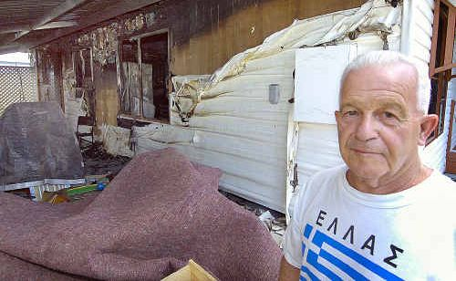 Mike Pye outside the burnt Golden Shores house which he shared with Rose Coy.