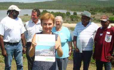 Author Dr Johanna Kijas holds up a new book containing stories of the Yuraygir National Park. Behind her are some of the contributors: Fox Laurie (Yaegl), Andrew Lugg (NPWS), Marie Preston, Ron Heron (Yaegl) and Cecil Laurie (Gumbaingirr).