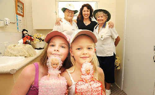 Lismore sisters Sascha, 10, and Dove Wilson, 7, hold two of the crocheted toilet roll covers that will decorate the ladies' toilets at the Lismore City Bowling Club's first Beats, Bowls and Bingo event this Sunday. Watching on are (from left) club vice-president Janet Boyd, the girls' mother Cath O'Halloran, and club vice-president Audrey Taylor. Ms O'Halloran is the partner of organiser Craig Wilson. Jacklyn Wagner