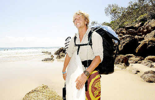 Jack Gradon, who is walking from Byron Bay to Sydney's Northern Beaches to raise money for the Warriewood Surf Club, pictured at Shark Bay, Evans Head, yesterday.