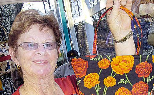 June Bellenger at one of the 2009 Torquay Twilight Markets with her hand-made handbags.