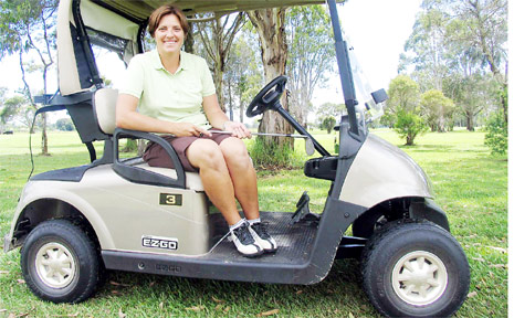 Nicole Picken, Mullumbimby Golf Club's new pro golfer, in one on the smart new carts.