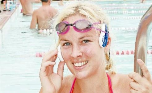 IN THE SWIM: Hayley Nissen models the new SwiMP3 underwater music player at Cotton Tree Pool.