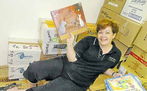 Sue Gammon of Bundaberg Library with boxes of books for the annual book sale this weekend at the civic centre.