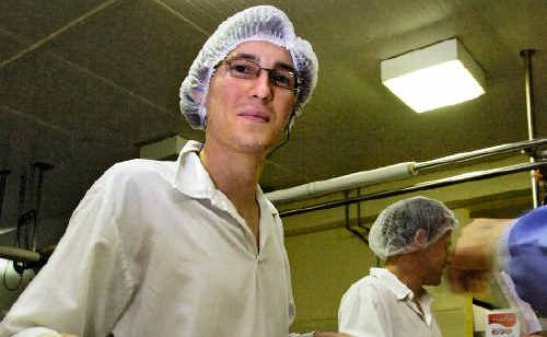 Beau Gilbert, a new employee at the Norco ice-cream factory in South Lismore, is helping meet demand from increased ice-cream sales due to the hot weather.