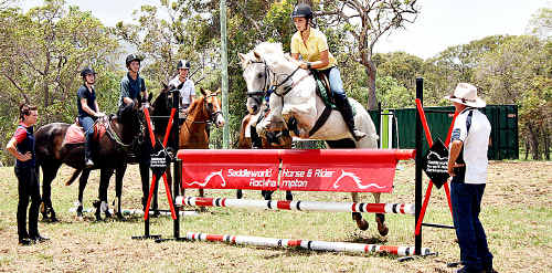 Matilda Mills puts on a show at a recent showjumping summer camp in Yeppoon with 60 other riders.