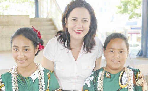 Minister Annastacia Palaszczuk was greeted by dancers Leah Beaton and Failelei Fokilelei of the Tongan community in Bundaberg.