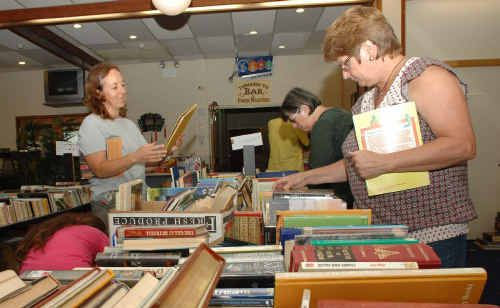 Over 500 people had been through the Maclean Rotary Book Sale by midday yesterday, snapping up thousands of books at bargain prices.
