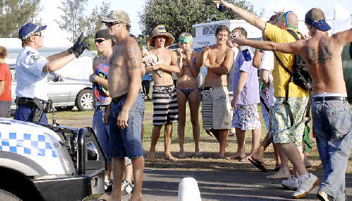 Police speak to revellers at Lennox Head on Australia Day 2009. Police have increased numbers in the local area to combat any alcohol-fuelled violence.