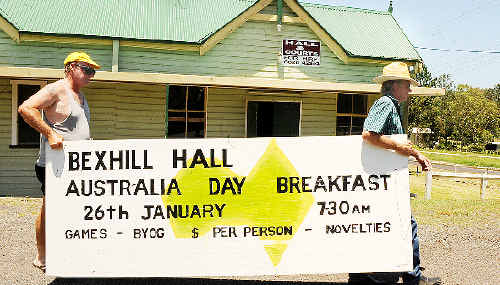 Bexhill Hall committee members Dave Dean (left) and Greg Johnston with the Australia Day breakfast sign taken down this week by Lismore City Council workers at the request of the RTA.
