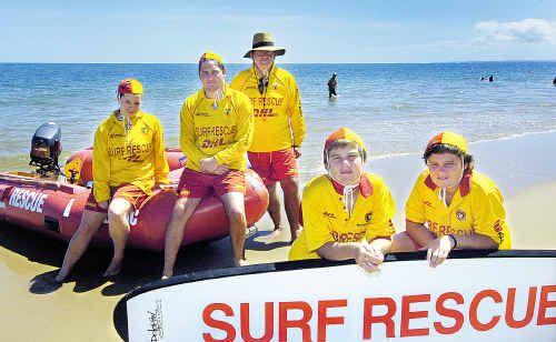 Hervey Bay surf lifesavers (from left) Renee Button, Nathan Finch, patrol captain John Gillard, Chris and David Bamford keep watch on Torquay beach.