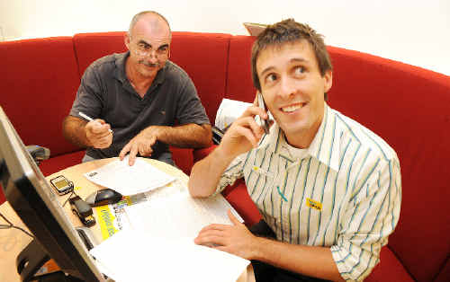 Mark Trollope (left), of Lismore, upgrades his mobile phone with the assistance of Optus Lismore sales assistant Matt Pratten.