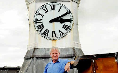 The Grafton Post Office clock is keeping time once again, thanks to Michael Brennan and his son, Aiden.
