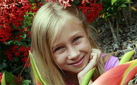 Jessica Bliss, 7, among the ginger flowers.