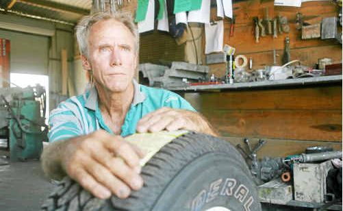 Brazen thieves stole tyres and rims from Ken Nielsen's workshop. Photo: DARRYN SMITH cri1901b