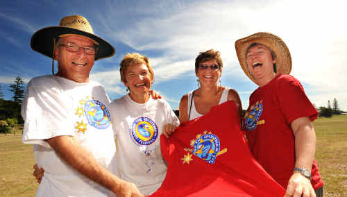 Live Prawn Production Inc volunteers (from left) Garry Brisbane, Ilma Hynson, Bev Mansfield and Jen Smith with a sample of one of the T-shirts that will be given away this Sunday at the Yamba River Markets.