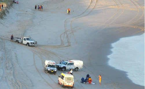Rescue vehicles on the beach.