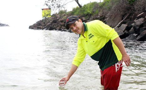 Byron Council's environmental health officer, David Bell, on the job collecting water samples for testing.
