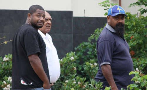 Accused illegal fishermen Leighton Cameron Little and Elwyn James Mann (both in foreground) leave Rockhampton Magistrates Court.