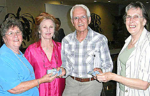 Retiring Friends of the Koala committee members Margaret Russell (left) and Kay Sherring (right) get the ball rolling by giving donations to Friends of the Koala president Lorraine Vass and vet Dr Geoff Tomkins for the Building Appeal.