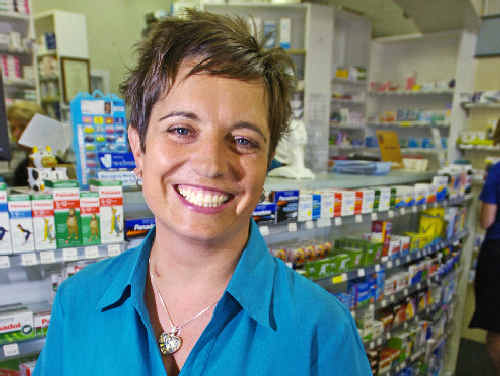 Heart transplant recipient Tracy Ross, of Alstonville, back at work at the Tamar Village Pharmacy in Ballina after her life-saving surgery in Sydney.