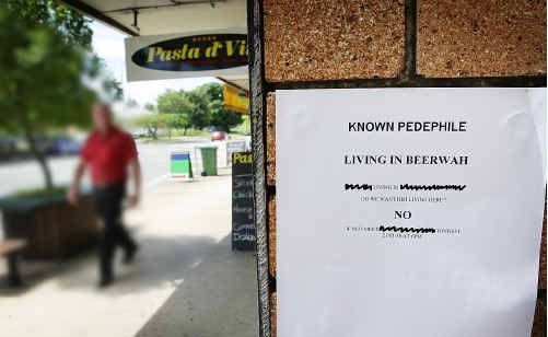 Signs attached to walls around Beerwah calling for a public meeting to discuss an alleged paedophile were taken down by police who feared vigilante action.