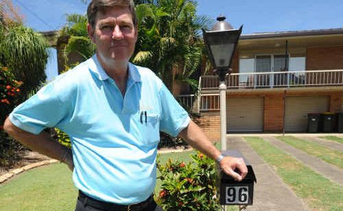 GDSC general manager Arthur Lysaught stands outside one of the six houses the club is selling.