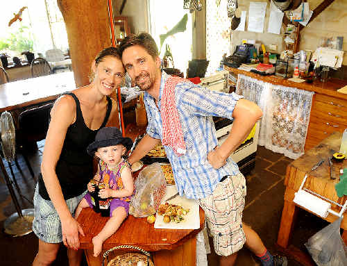 Busy preparing their wedding feast are Anastasia De Re, of Goonellabah, and chef Maximillian Lundin, from Sweden, with their 17-month-old Swedish daughter Molly De Re.