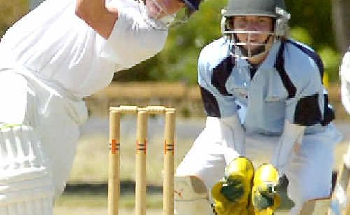 Sam Reading, from the Far North Coast team, keeps wicket as New Zealand's Jeremy Winchester drives a ball straight at Nielson Park, East Lismore, yesterday.