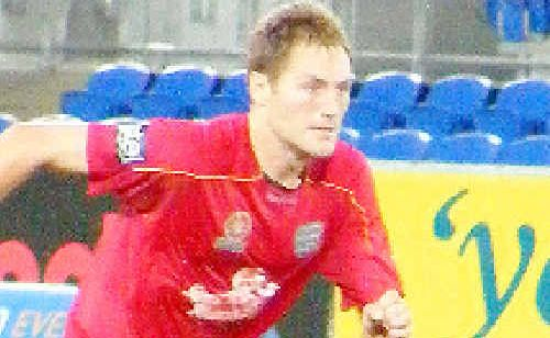 Former Goonellabah player Adam Hughes in action for Adelaide United in an A-League game against Gold Coast United at Robina this month. The midfielder came on in the second half. The game ended 1-all when Gold Coast scored in the final minute of injury time.