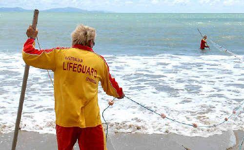 Lifeguard supervisor Paul Barker and lifeguard Derek Murphy drag for stingers.