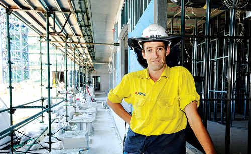 Leading hand Adam Overall on-site as construction of the Nambour hospital expansion steams ahead.