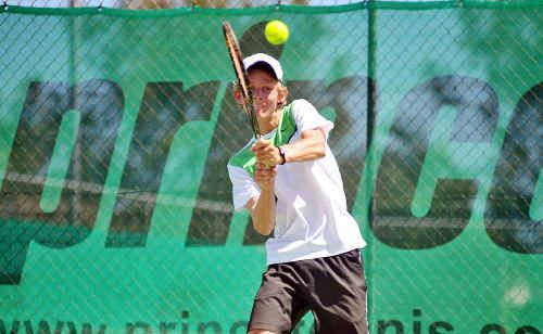 Nicolas Cameron returns during the 16-and-under boys final at the Sunshine Coast junior tennis championship.
