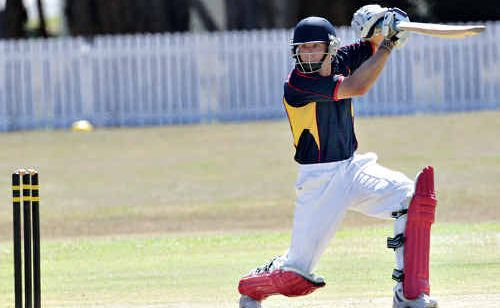 Maroochydore's John Clifford sends the ball to slip as he attempts to slow the Caloundra juggernaut.