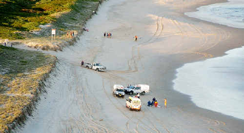 Emergency workers in action during last week's drownings at South Ballina Beach.