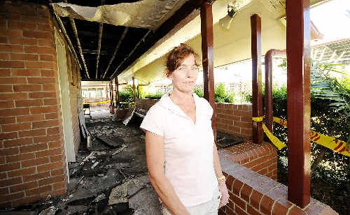Emmanuel Anglican College principal Heidi O'Brien inspects damage caused by the fire in a toilet block at the West Ballina school.