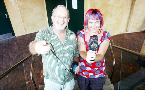 Looking for old Byron Bay movie footage . . . Greg Aitken and Byron Bay Film Festival director J'aimee Skippon-Volke at the Byron Bay Community Centre.