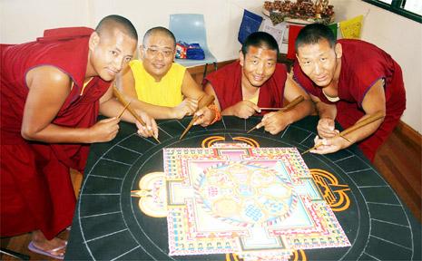 Creating the sand mandala are (from left) Dhondup Tsering, Geshe Tenzin Demchok, Thiley Dorjee and Ngawang Tashi.