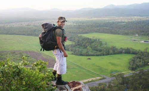 Petros Khalesirad looks out across the Rockhampton district from a lofty height on Mt Jim Crow. The city businessman is determined to climb the highest peak on each continent.