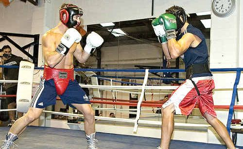 Hervey Bay's Jarrod Fletcher (left) gives it his all sparring against Trent Broadhurst, who will represent Australia at the Commonwealth Games this year, in Brisbane this week. Fletcher will defend his Pan Asian Boxing Association middleweight title at the Hervey Bay PCYC on February 27.