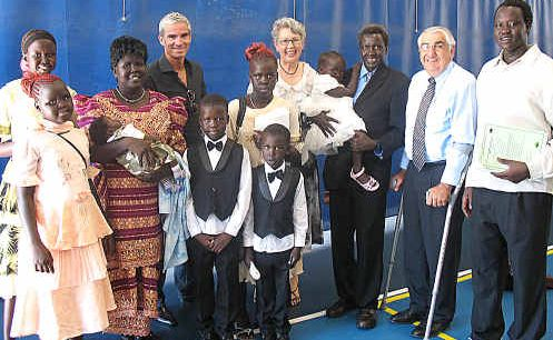 Australia Day ambassador Craig Foster, Lismore Mayor Jenny Dowell and Lismore MP Thomas George with the Kuol family, who became Australia citizens on Tuesday.