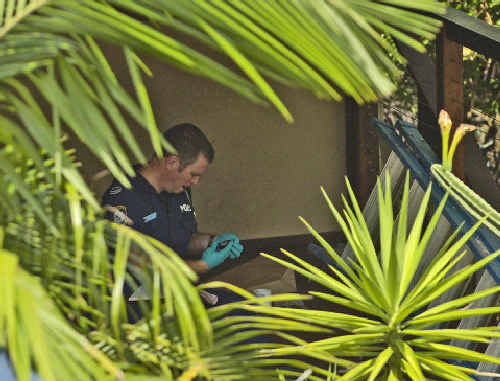 An officer from Strike Force Barsden begins his investigation after executing warrants at the Byron Bay house.