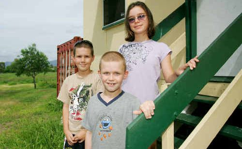 Rachel Hillier's children Keegan, 10, Bronte, 13, and Oakley wonder if they will be forced out once again by rising waters after predicted heavy rain in Central Queensland this weekend.