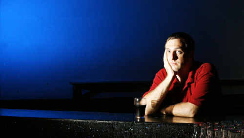 Players International manager Daniel Thomas sits alone in the bar as Ipswich experiences low turnouts to entertainment venues.
