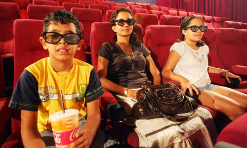 Anjali Datar (centre) with her children Anuj (left) and Manali watch the credits roll after seeing Avatar, now the highest grossing film of all time.