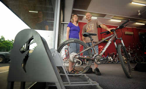 Owners of Grafton City Cycles, Sue Webber and Trevor Creighton, with the bike rack they have in the shop for cyclists to leave their bikes while shopping in the CBD.