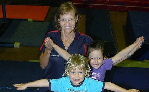 Coach Stacey Parsons with little gymnasts (front) Sahara Cashion, 4, Zoe Butler, 3, and Lara Christ, 4, who has just graduated from kindy gym.