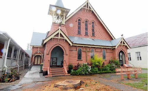 The large camphor laurel tree, below, that has stood outside St Paul's Uniting Church in Macalister Street for decades was felled on Saturday, clearing the way for a new driveway.
